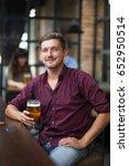 smiling handsome man holding... | Shutterstock . vector #652950514