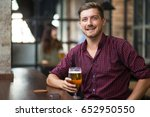 happy handsome man holding... | Shutterstock . vector #652950550