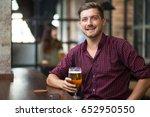 happy handsome man holding...   Shutterstock . vector #652950550