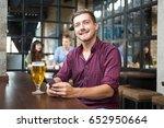 smiling man with smartphone and ...   Shutterstock . vector #652950664