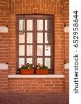 Wooden Window In A Brick Wall