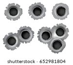 realistic bullet impacts on... | Shutterstock . vector #652981804