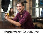 happy attractive man holding... | Shutterstock . vector #652987690