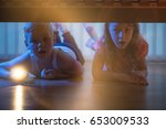 the boy and girl lay on the... | Shutterstock . vector #653009533