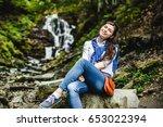 happy young woman enjoying... | Shutterstock . vector #653022394