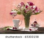 bouquet of lilies of the valley with tulips and ice cream with - stock photo