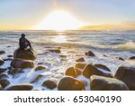 person sitting on a rock... | Shutterstock . vector #653040190