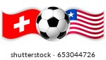 swiss and liberian wavy flags... | Shutterstock .eps vector #653044726