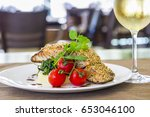 seared salmon fillet with wine... | Shutterstock . vector #653046100