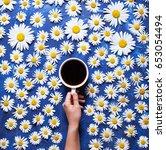 floral summer background. a mug ... | Shutterstock . vector #653054494