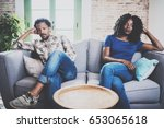 young displeased black couple... | Shutterstock . vector #653065618