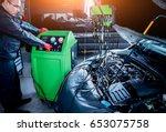 servicing car air conditioner....   Shutterstock . vector #653075758