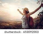 happy traveler with backpack... | Shutterstock . vector #653092003
