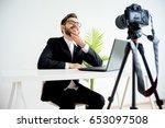 smiling video blogger | Shutterstock . vector #653097508