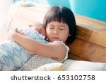 little sister hugging her... | Shutterstock . vector #653102758