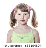 Small photo of Serious eight year old girl with pigtails, isolated on white