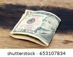 a picture of a folded ten usa... | Shutterstock . vector #653107834
