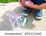 a young boy is drawing on the... | Shutterstock . vector #653112160