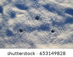 Small photo of Three concentric circles in snow