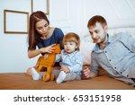 loving mother watching daughter ... | Shutterstock . vector #653151958