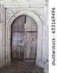 wooden door on an old stone... | Shutterstock . vector #653169496