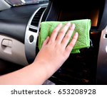 hand with microfiber cloth... | Shutterstock . vector #653208928