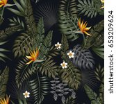 Tropical Leaves And Flowers In...