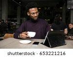 african american man uisng talet | Shutterstock . vector #653221216
