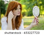 beautiful woman with mirror | Shutterstock . vector #653227723