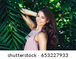 beautiful smiling woman posing... | Shutterstock . vector #653227933