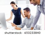 business people in modern office | Shutterstock . vector #653233840