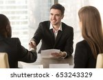 happy applicant greeting... | Shutterstock . vector #653243329