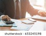 a business woman analyzing...   Shutterstock . vector #653245198