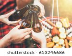 friends clinking bottle of beer ... | Shutterstock . vector #653246686