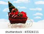A Wicker Sleigh With Presents...