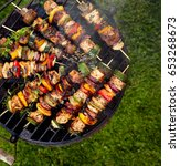 grilled skewers on a grilled... | Shutterstock . vector #653268673