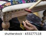 man working in upholstery...   Shutterstock . vector #653277118