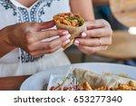 female hands holding tasty... | Shutterstock . vector #653277340