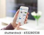 female hands holding phone with ...   Shutterstock . vector #653280538