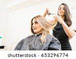 pretty brunette working as a... | Shutterstock . vector #653296774