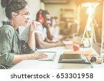 young trendy teamwork using... | Shutterstock . vector #653301958