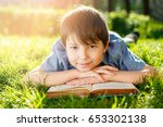 schoolboy in the nature with a... | Shutterstock . vector #653302138