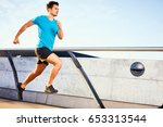 young man running fast on bridge | Shutterstock . vector #653313544