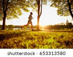 young man running in park... | Shutterstock . vector #653313580