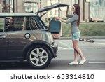 beautiful girl is putting... | Shutterstock . vector #653314810