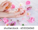 woman applying perfume on her... | Shutterstock . vector #653326060