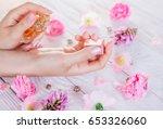 woman applying perfume on her...   Shutterstock . vector #653326060