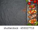 appetizer bruschetta with pear  ... | Shutterstock . vector #653327713
