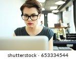 hipster woman use laptop huge... | Shutterstock . vector #653334544