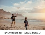 father and son operating the... | Shutterstock . vector #653350510